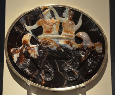 Hadrian as ruler of the world: Sardonyx cameo depicting an allegorical triumph of Hadrian crowned by Roma in a chariot pulled by eagles, originally made for Claudius around 50 AD and the head later reworked into a portrait of Hadrian in 117-118 AD, Altes Museum