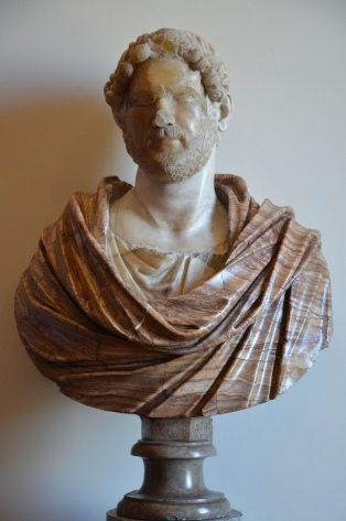 Fragmented head of Hadrian in alabaster on a modern bust (type: Imperatori 32), sculpture head: Hadrianic period; bust 18th century, the head has been restored with marble, Musei Capitolini, Rome