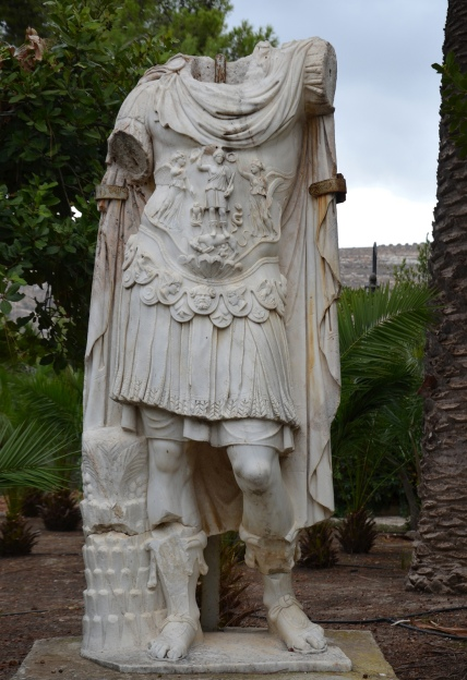Headless statue of Hadrian. He is shown as a triumphant army commander with a cuirass. Found in Knossos Villa of Dionysos, peristyle house of the Roman period. Now in the gardens of Villa Ariadne, Knossos.