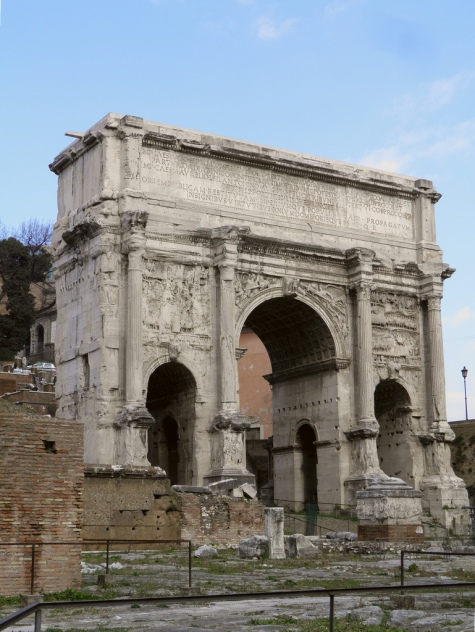 The Arch of Septimius Severus at the northwest end of the Roman Forum. A triumphal arch dedicated in AD 203 to commemorate the Parthian victories of Emperor Septimius Severus and his two sons, Caracalla and Geta, in the two campaigns against the Parthians of 194/195 and 197-199