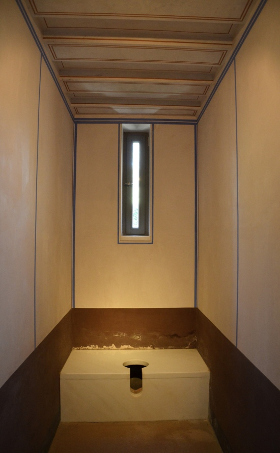 Reconstruction of a single latrine next to the culina (kitchen) at the Pompejanum (Germany), an idealized replica of a Roman villa.