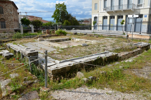 The latrines, intended to serve the public that frequented the Roman Agora in Athens. It was a rectangular hall with seats on 4 sides. It was roofed except for the centre area which was open for ventilation, 1st century AD.