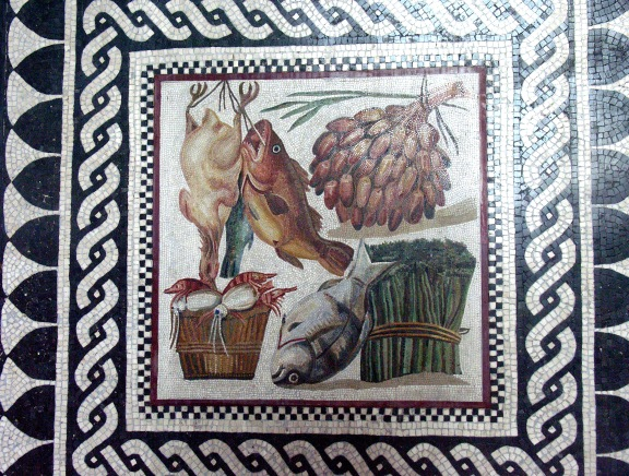 Roman mosaics of food belonging to an ancient triclinium (dining room). On it are represented various foods such as a fowl, fish, asparagus, dates and other fruit © jere7my