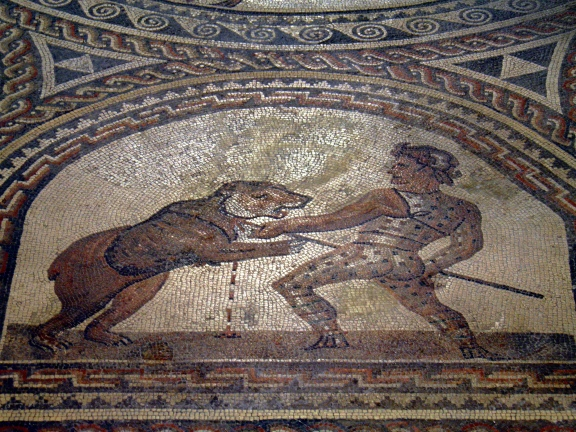 Detail of the Gladiator mosaic floor, a Venator fighting a bear, Römerhalle, Bad Kreuznach Carole Raddato