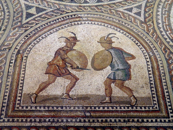 Detail of Gladiator mosaic, two Eques fighting equipped with lance, sword and the traditional small round shield, Römerhalle, Bad Kreuznach Carole Raddato