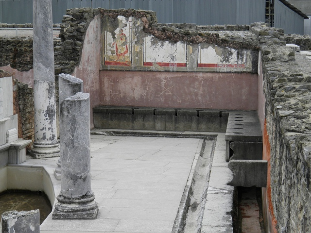 The latrines of the Baths of the Wrestlers at Saint-Romain-En-Gal (France). They were luxurious public toilets adorned with fresco representing wrestlers and referee.