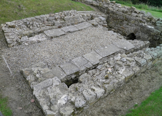 The Latrine building at Vindolanda Fort along Hadrian's Wall. These latrines could have accommodated up to 16 soldiers at a time, seated on timber benches above the sewer channels.