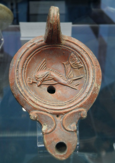 Terracotta oil lamp depicting a dolphin carrying a trident, probably related to Neptune, 1st-2nd century AD