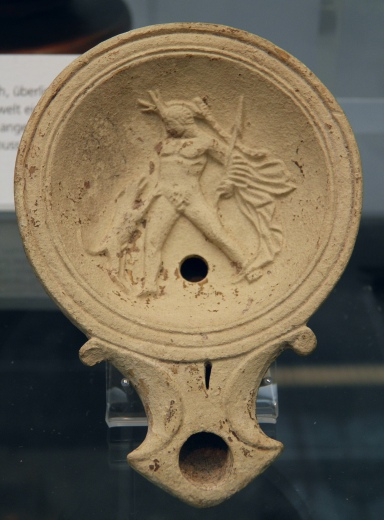 Terracotta oil lamp depicting Actaeon torn apart by dogs, 1st century AD