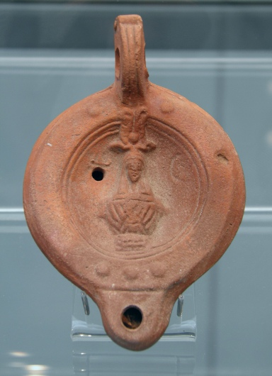 Clay oil lamp depicting Isis, from Egypt, 2nd century AD