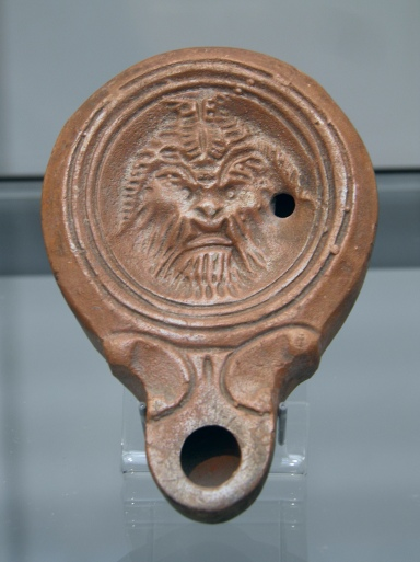 Clay oil lamp depicting Pan the god of shepherds and flocks, 1st-2nd century AD