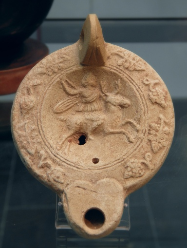 Roman oil lamp depicting the goddess Diana as a huntress, 2nd-3rd century AD