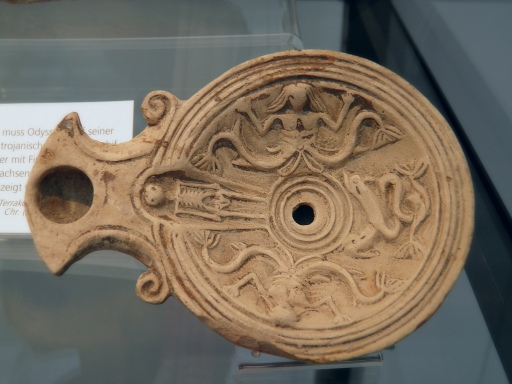 Oil lamp depicting Scylla a monstrous sea goddess, 2nd century AD