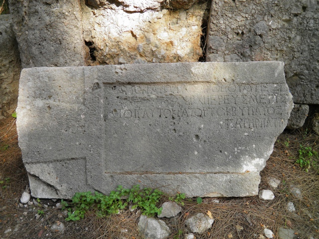 Inscription written in honor of the emperor Domitian found above one of the two gates that faced the main street, Phaselis © Carole Raddato