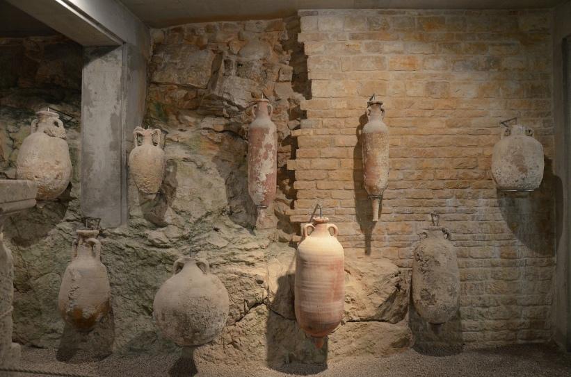Permanent exhibition of amphorae in the underground area of Pula's amphitheatre © Carole Raddato