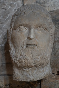 Rustic head of Jupiter or Hercules, 3rd - 4th century AD, on display in the Temple of Augustus