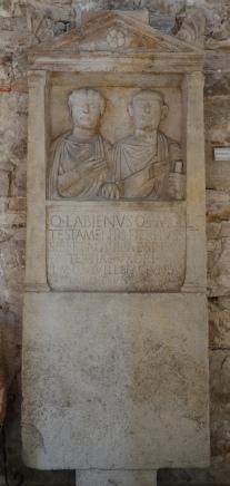 Sepulchral stele of Quintus Labienus Mollio and his wife Aquilia Tertia, 1st century AD, on display in the Temple of Augustus