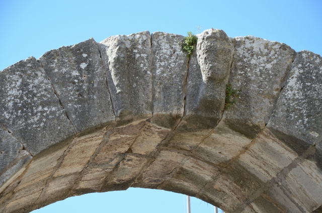 Gate of Hercules, head of Hercules and his club, Pula © Carole Raddato