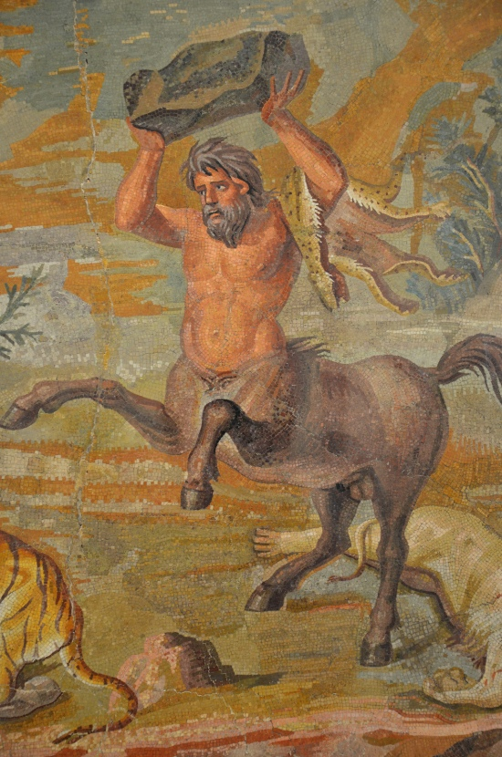 Detail of the Centaur Mosaic; the male holding a rock aloft above his head © Carole Raddato