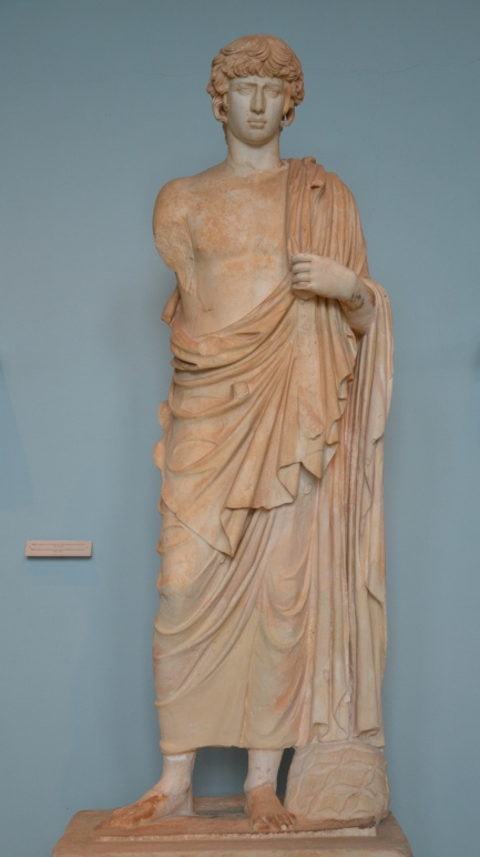Statue of the deified Antinous represented as Asklepios, found in the outer court of the sanctuary which it apparently adorned, 2nd century AD, Archaeological Museum of Eleusis