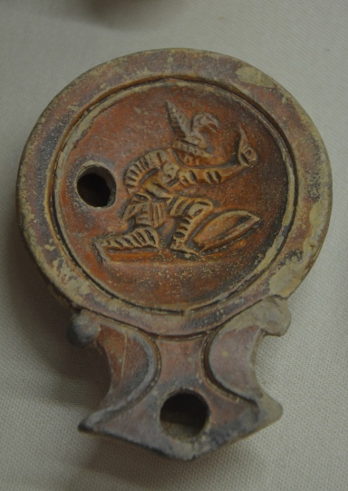 Oil lamp depicting a gladiator with shield and sword, 2nd half of 1st century AD - beginning of 2nd century AD, from Salona, Split Archaeological Museum © Carole Raddato