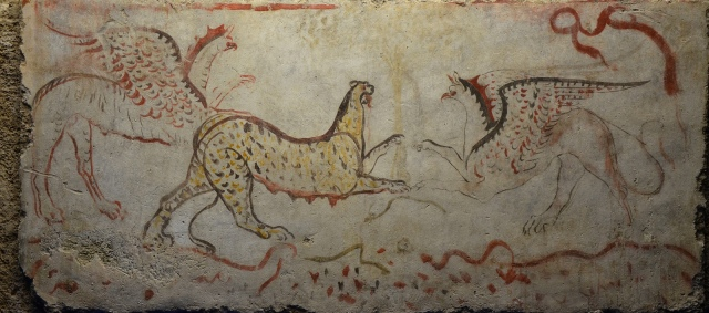 Painted travertine slab showing two griffins attacking a panther, 340 BC, found in tomb 58 at Andriuolo, Paestum, Monsters. Fantastic Creatures of Fear and Myth Exhibition, Palazzo Massimo, Rome © Carole Raddato