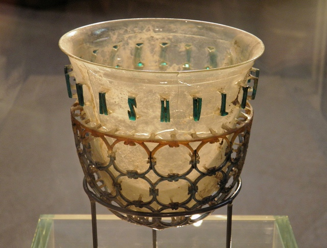 "The so-called Trivulzio Diatreta Cup, a 4th century glass jug surrounded by a web of glass circles, around the surface runs Latin inscription ""BIVE VIVAS MULTIS ANNI"": ""Drink and live many years"", Civico museo archeologico di Milano © Carole Raddato"