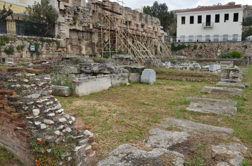 "The Library of Hadrian, the eastern end of the peristyle court with the remains of several rooms, the room (with the scaffolding) would have been the ""library"" proper, where ancient scrolls were stored, Athens © Carole Raddato"