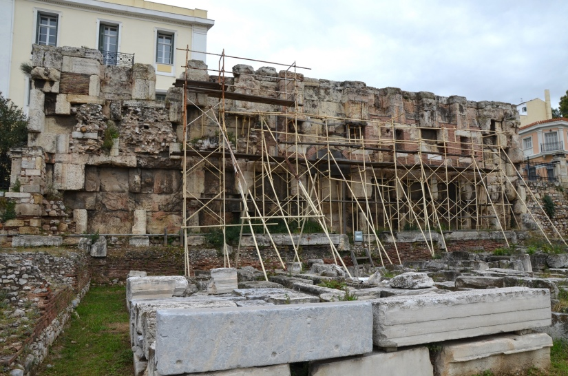 "he Library of Hadrian, the eastern end of the peristyle court with the remains of several rooms, the room (with the scaffolding) would have been the ""library"" proper, where ancient scrolls were stored, Athens © Carole Raddato"