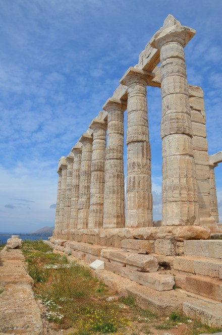 Temple of Poseidon, part of the south colonnade with foundations of the earlier poros temple dating from the Archaic Period, Cape Sounion © Carole Raddato