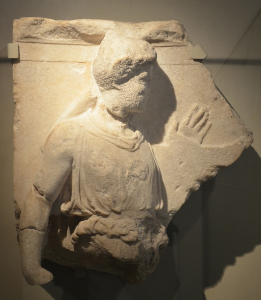 The Bassai sculptures, male figure wearing a chiton and an alopekis (Thracian cap), holding a kithara, may be identified as Apollo or Orpheus, fragment of the north metope from the Temple of Apollo Epikourios at Bassae (Arcadia), British Museum