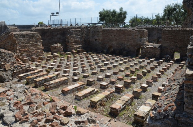 The tepidarium, the warm bathroom of the baths complex heated by a hypocaust (underfloor heating system), Minturnae © Carole Raddato