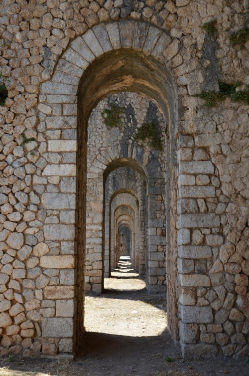 The 12 pillared arches of the cryptoporticus of the so-called Sanctuary of Jupiter Anxur, Terracina, Italy © Carole Raddato