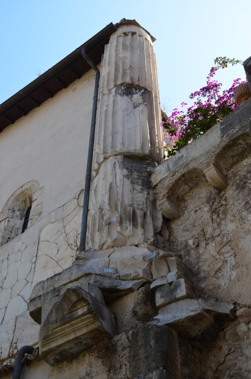 Side wall of Cathedral of SS. Pietro e Cesareo with a remaining column from the Temple of Rome and Augustus still visible, Terracina (Anxur), Terracina, Italy © Carole Raddato