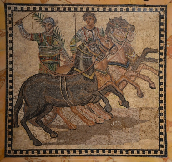 Mosaic depicting a quadriga of the factio prasina ('the greens,' representing the spring), 3rd century AD, from Rome National Archaeological Museum of Spain, Madrid © Carole Raddato