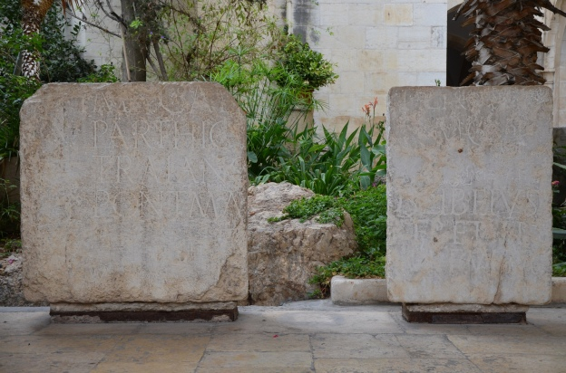 Two fragments of an imperial inscription in Latin from Aelia Capitolina dedicated to Hadrian, on display in the courtyard of Studium Biblicum Franciscanum Museum, Jerusalem © Carole Raddato