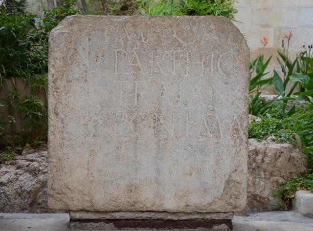 Fragment of an imperial inscription in Latin from Aelia Capitolina dedicated to Hadrian, on display in the courtyard of Studium Biblicum Franciscanum Museum, Jerusalem
