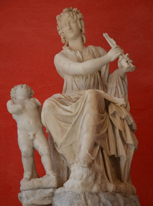 The Muse Euterpe, muse of lyric poetry, she is holding a aulos (double-flute) and has a small Eros at her feet, unearthed at Hadrian's Villa, Tivoli © Carole Raddato