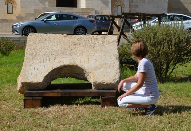 Here I am in front of the Latin inscription dedicated to Hadrian reveiled in Jerusalem on Wednesday 20th October 2014 © Carole Raddato
