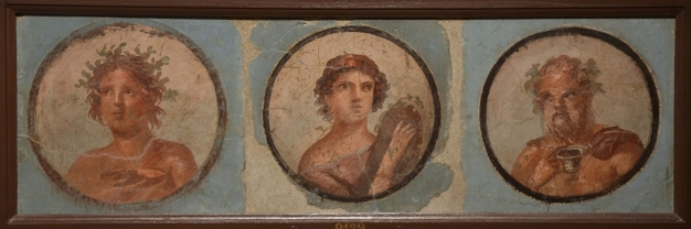 Fresco in the Fourth Pompeian Style with portraits set in medallions with blue background, from the exedra of the House of the Mosaic Atrium, 50-79 AD Empire of colour. From Pompeii to Southern Gaul, Musée Saint-Raymond Toulouse © Carole Raddato