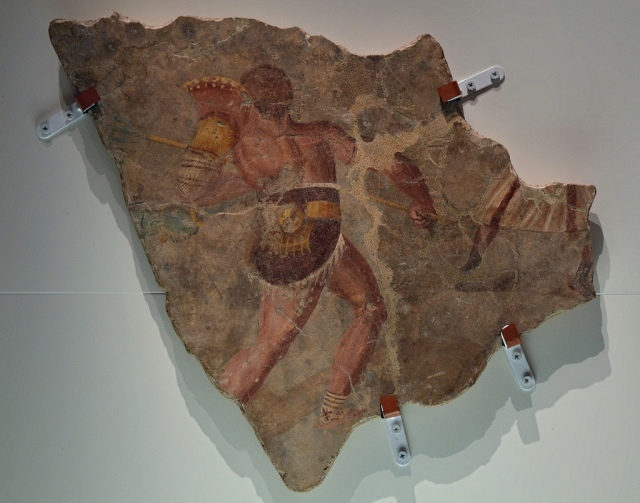 Fresco fragment with a gladiatorial scene (munus gladiatorium), from the Forum of Vesunna (Périgueux), 2nd century AD Empire of colour. From Pompeii to Southern Gaul, Musée Saint-Raymond Toulouse On loan from Vesunna Gallo-Roman Museum, Périgueux Carole Raddato CC BY-SA