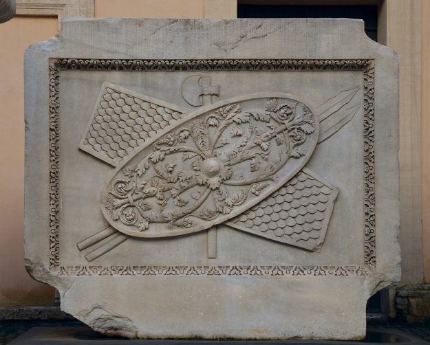 Trophy of arms (shields, axes and spears) relief from the Hadrianeum, a temple of the deified Hadrian in the Campus Martius erected by Antoninus Pius in 145 AD, Capitoline Museum © Carole Raddato