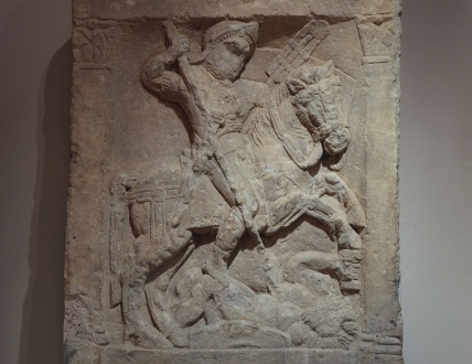 Tombstone of an auxiliary cavalryman called Sextus Valerius Genialis, the deceased is depicted on horseback spear in hand with a fallen enemy at the horse's feet, 1st century AD, from Corinium Dobunnorum, Corinium Museum (Cirencester)