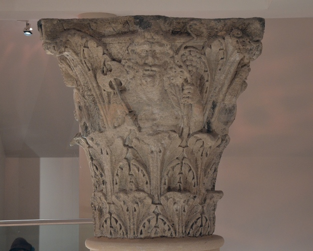 The Jupiter Column's Corinthian capital, Lycurgus holding a vine staff and a double-headed axe, Corinium Museum, Cirencester Carole Raddato CC BY-SA