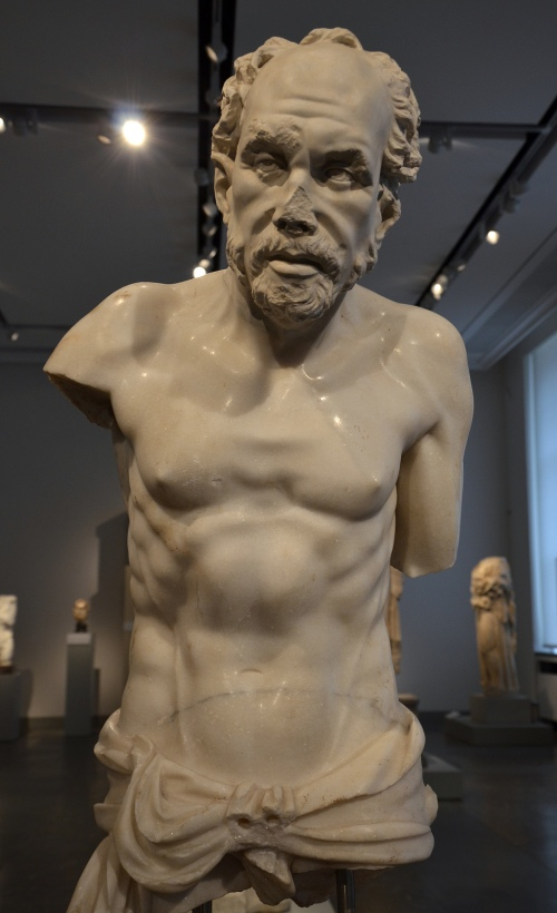 The Aphrodisias old fisherman, dating between 150 and 250 AD, the head is a plaster cast of the original, discovered at Aphrodisias in 1989, Altes Museum, Berlin Carole Raddato CC BY-SA