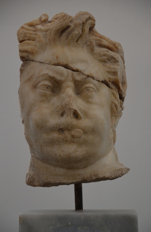 Head of a Satyr playing the double flute, found in the Hadrianic Baths, late 2nd or 3rd century AD, Aphrodisias Museum Carole Raddato CC BY-SA
