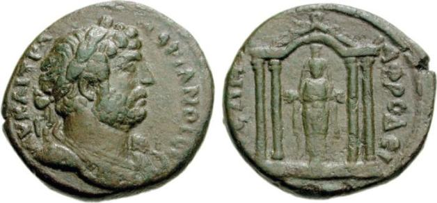 Hadrian AE28 Diassarion of Caria, Aphrodisias. AV K LI TPAIN ADPIANOC CE, laureate and cuirassed bust right, seen from front, slight drapery on left shoulder / AFRODEICIEWN, cult state of Artemis of Aphrodisias standing facing within tetrastyle shrine with arched central bay; ornate roofline.
