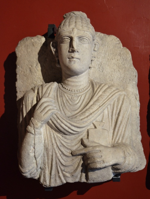 Funerary bust of a woman from Palmyra, she is holding a writing tablet, on her left hand Roman Imperial period, 3rd century AD Vatican Museums, Rome Carole Raddato CC BY-SA