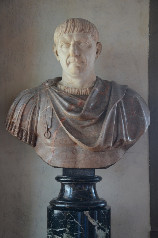 Bust with the head of Trajan, ca. 105 AD, the head is inserted in a modern bust of red marble,  Galleria degli Uffizi, Florence Carole Raddato CC BY-SA