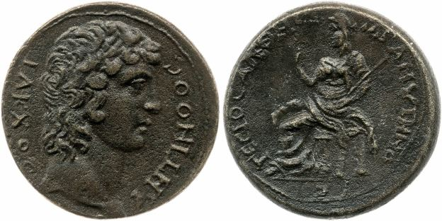 Commemorative coin minted by Gessius at Adramyttium. OBV: Antinous as Iacchos, with legend IAKXOC | ANTINOOC REV: